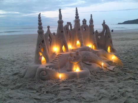 Sand castle with candles.