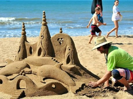 Sand castle with dolphins.