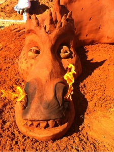 Fire breathing dragon made with red sand.