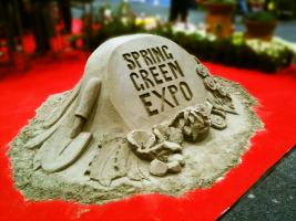 Spring Green Expo logo in sand.