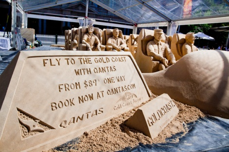Qantas logo in sand for corporate sand sculpture event.