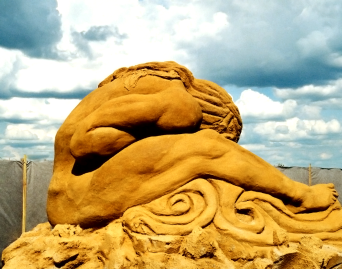 Man Shipwrecked shielding face.