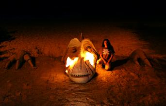 Huge dragon head breathing fire on the beach.