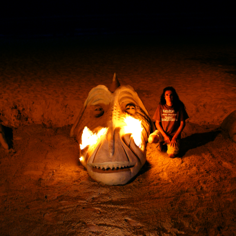 Huge dragon head breathing fire on the beach.