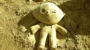 Sand sculpture of Stewie Griffin.