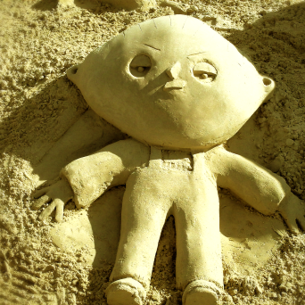 Sand sculpture of Stewie Griffin.