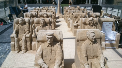 Sand sculptures of passengers for corporate sand sculpting event.
