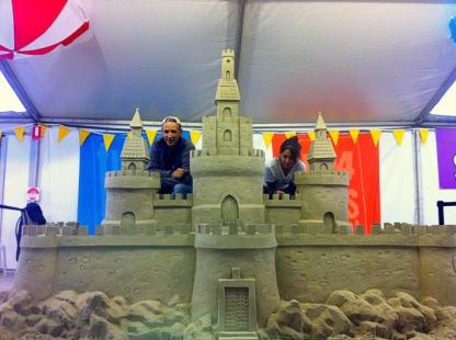 Large sand sculpture of a castle.