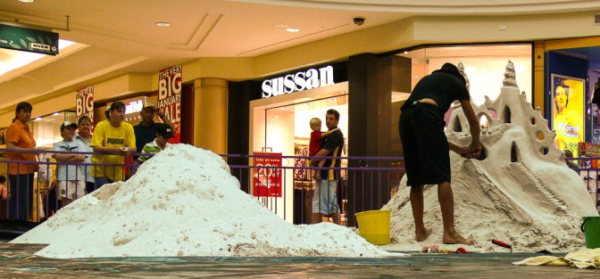 Sand sculpture installation in shopping center.