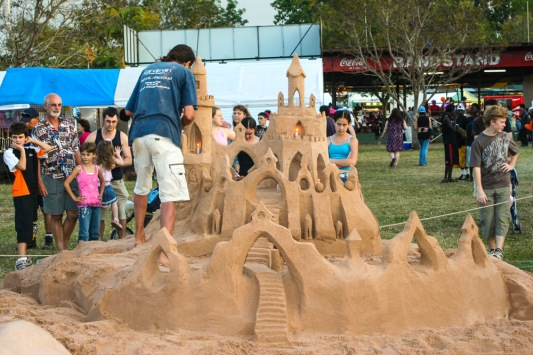 Sand sculpting a beautiful castle at a festival.