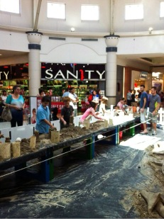 Sand sculpting workshop in a shopping center.